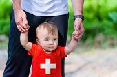 Little Boy In Switzerland Flag Shirt