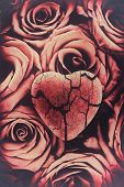 foto of broken heart flower  - A broken cracked heart on top of a group of red roses - JPG