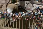 Love locks hang under the Charles Bridge in Prague