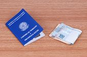 Brazilian Work Document And Social Security Document (carteira De Trabalho) And Brazilian Currency (