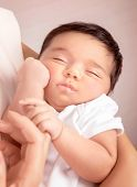 Cute sleeping baby portrait, mother holding on hands sweet newborn toddler, happy childhood, new lif
