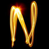 N - Created by light alphabet over black background