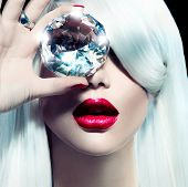 stock photo of  lips  - High fashion portrait of beauty model girl with a big diamond - JPG