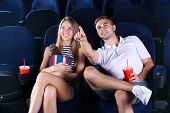 Young couple watching movie in cinema