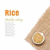 Whole Unpolished Organic Rice In Bowl Isolated On White
