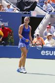 Professional tennis player Sara Errani celebrates victory after fourth round match at US Open 2014