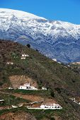 picture of snow capped mountains  - Countryside near Arenas with the snow capped mountains of the Sierra Almijara to rear Arenas Malaga Province Andalusia Spain Western Europe.