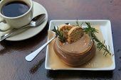 Serving of Chocolate mousse with rosemary twigs