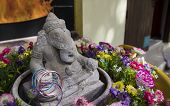 pic of vedic  - the lord of ganesha statue in the middle of flower - JPG