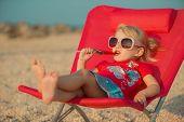 Portrait of cute little girl at tropical beach