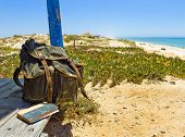 Backpacking Traveller In A Beach Rest. Tavira Island, Algarve. Portugal