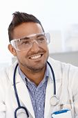 Portrait of young doctor wearing safety googles.