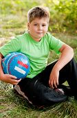 The Boy With The Ball On The Nature