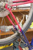 Closeup of bike wheel over workshop table