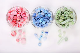 picture of crown green bowls  - Beads in glass bowls isolated on white - JPG