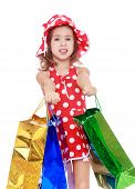 Little girl holds up a lot of big bright holiday packages.