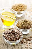picture of flax seed oil  - Bowls of whole and ground flax seed with linseed oil - JPG