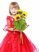 Little princess holding a bright yellow flowers.