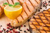 Two salmon steaks on platter.