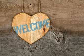 Welcome Message Wooden Heart Sign On Rough Grey Wooden Background