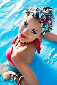 picture of turban  - Beautiful fashionable woman in the pool wearing colored turban