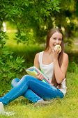 Young student with books and apple