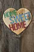 'home Sweet Home' Message Wooden Heart Sign On Rough Grey Wooden Background