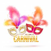 Bright carnival masks with feathers and golden sign Welcome to Carnival