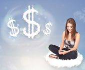Pretty young woman sitting on cloud next to cloud dollar signs