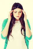 Young casual woman suffering from headache.