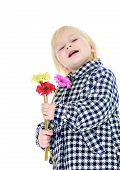 Adorable little girl with a bouquet in hand.