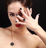 Sexy Makeup Model With Black Nails Gloss Looking. Closeup Portrait