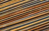 picture of reinforcing  - Stack of the metal rusty reinforcement bars - JPG