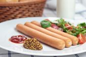 pic of wieners  - Wiener sausage with ketchup mustard and salad - JPG