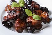 Pork Ribs Stewed With Prunes And Basil Close-up.