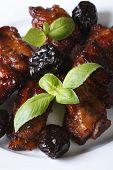 Pork Ribs Stewed With Prunes And Basil. Vertical Close-up.