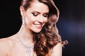 pic of jewelry  - beautiful fashion model with perfect makeup wearing jewelry - JPG