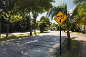 picture of hump  - Topes speed bump sign at caribbean street Playa del Carmen Mexico - JPG