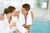 Luxury Spa - Young Happy Couple Relax At Swimming Pool