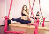 stock photo of aerialist  - Beautiful dancer training with aerial silk in a fitness studio