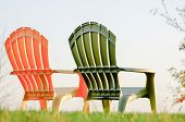 stock photo of lawn chair  - Two lawn chairs on a green grass - JPG