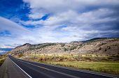 Empty Asphalt Highway Through Mountainous Country