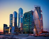 stock photo of illuminating  - Illuminated Skyscrapers Buildings of Moscow City business complex at dusk Moscow Russia.