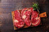 Raw Fresh Meat Ribeye Steak Entrecote On Dark Wooden Background