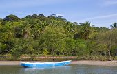 Lonesome fishing boat in the amazon of brazil: Rain forest near Salvador in the Bahia de Todos. Landscape with a traditional handmade boat of wood.