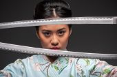 Japanese woman with two katanas