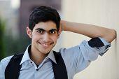 Happy teenage boy posing