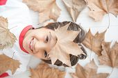 Happy kid with leaves