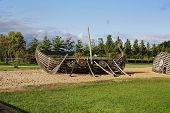 foto of viking ship  - the decoration of the Park in the form of a Viking ship on the background of trees and lakes - JPG