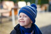 Happy Little Boy In Winter Cap And Scarf